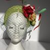green sinamay halo with flowers and feathers